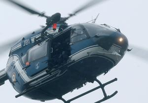 A helicopter with members of the French intervention gendarme forces hover above the scene of a hostage taking at an industrial zone in Dammartin-en-Goele, northeast of Paris. Reuters/Christian Hartmann
