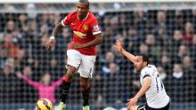 Manchester United's Ashley Young (L) runs past Tottenham Hotspur's Andros Townsend during their English Premier League soccer match at White Hart Lane