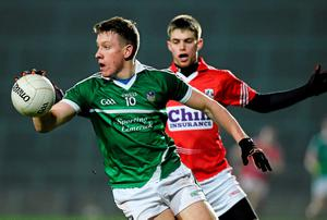 Evan Quinlan, Limerick, in action against Cian Kelly, Cork