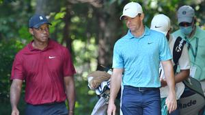 Tiger Woods and Rory McIlroy walk to the 9th tee during the final round of The Northern Trust golf tournament at TPC of Boston. Photo: Mark Konezny-USA TODAY Sports