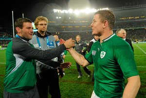 Ireland captain Brian O'Driscoll celebrates with team-mate Fergus McFadden after victory over Australia in 2011