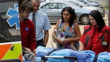 Ashya King, a 5-year-old British boy with a brain tumour, lies on a stretcher as he arrives with his parents Brett (2nd L) and Naghemeh King (2nd R) at the Proton Therapy Center in Prague September 9, 2014. REUTERS/David W Cerny