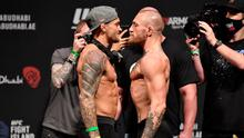 Dustin Poirier and Conor McGregor face off during the UFC 257 weigh-in at Etihad Arena on UFC Fight Island in Abu Dhabi, United Arab Emirates. (Photo by Jeff Bottari/Zuffa LLC via Getty Images)