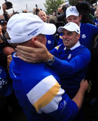 Europe's Jamie Donaldson (left) celebrates with captain Paul McGinley after winning the Ryder cup on day three of the 40th Ryder Cup at Gleneagles Golf Course, Perthshire. PRESS ASSOCIATION Photo. Picture date: Sunday September 28, 2014. Photo credit should read: Mike Egerton/PA Wire. RESTRICTIONS: Use subject to restrictions. Editorial use only. No commercial use. Call +44 (0)1158 447447 for further information.