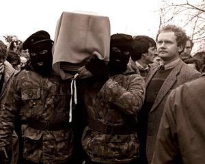 Martin McGuinness with masked IRA men at the funeral of Brendan Burns in 1988