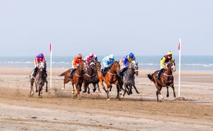 Horses race to the finish line at Laytown Beach. Held in early September each year, it is the only race meeting run on a beach under the rules of the Turf Club throughout Ireland the the UK.