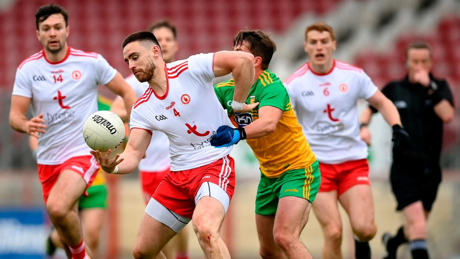 Padraig Hampsey of Tyrone in action against Peadar Mogan of Donegal