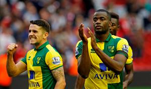 Norwich's Sebastien Bassong and Robbie Brady celebrate after the game