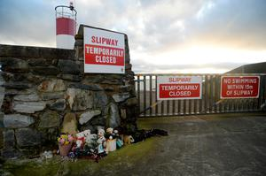 Tributes at the pier in Buncrana, Co Donegal. Photo: Caroline Quinn
