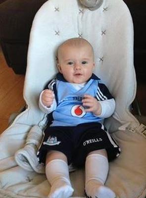 His Father is a staunch Dub fan and his Grandfather is a dyed in the wool Mayo Man... so Jonnie Doyle (4 months) has chosen to go with the Dubs!