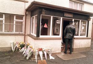 A row of flowers lie outside the Heights Bar in Co Down after the Loughinisland massacre