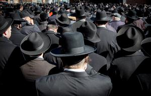 Mourners attend the funeral for seven children killed in a Brooklyn fire in New York March 22, 2015.  REUTERS/Brendan McDermid