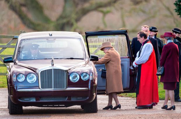 Heavy is the head: Queen Elizabeth leaves after attending a church service at St Mary Magdalene Church in Sandringham, Norfolk. Photo: Joe Giddens/PA Wire