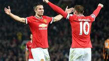 Robin Van Persie celebrates with Wayne Rooney after scoring Manchester United's third goal in their Premier League win over Hull City at Old Trafford. Photo: Martin Rickett/PA Wire