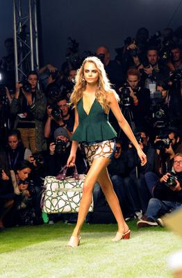 LONDON, ENGLAND - SEPTEMBER 15: Cara Delevingne walks the runway at the Unique SS14 runway show during London Fashion Week on September 15, 2013 in London, England.  (Photo by David M. Benett/Getty Images for Topshop Unique)