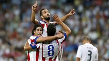 Arda Turan of Atletico de Madrid celebrates with teammates after scoring during the La Liga match between Real Madrid CF and Club Atletico de Madrid at Estadio Santiago Bernabeu. Photo credit: Victor Carretero/Real Madrid via Getty Images