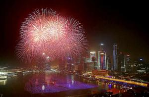 Fireworks explode over the financial district in Singapore. Celebrations started on New Year's Eve where concerts were held and thousands gathered on the streets to usher in the Year 2014. Photo: AP Photo/Wong Maye-E