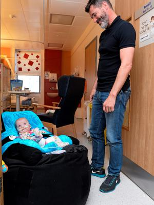 11 June 2015; Republic of Ireland manager Martin ONeill and assistant manager Roy Keane took time out of their busy preparation for Saturdays must win qualifier against Scotland to make a very special visit to Temple Street Childrens University Hospital today, where they met brave little patients, along with their parents and staff. The Irish legends made the visit in conjunction with the SportsWorld FAI Summer Soccer Schools, who earlier this year announced Temple Street as their charity of the year. SportsWorld, part of the Heatons department store group, are delighted to be title sponsor of the FAI Summer Soccer Schools. You too can support Temple Street Childrens Hospital by donating 1 when you book your camp online at www.summersoccerschools.ie. Pictured are Republic of Ireland assistant manager Roy Keane with Santa Ture, age 7 months, from Drogheda, Co. Louth. Temple Street Hospital, Dublin. Picture credit: David Maher / SPORTSFILE