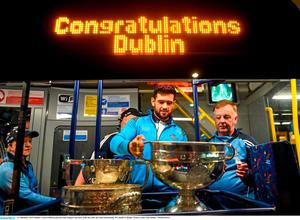 21 September 2015; Dublin's Cian O'Sullivan puts the Sam Maguire cup back on the bus after the team homecoming. O'Connell St, Dublin. Picture credit: Paul Mohan / SPORTSFILE