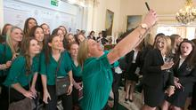 Irish Hockey player Kate Dillon from Dalkey takes a selfie of her team during an International Women's Day  reception for over 100 Irish sportswomen by President Michael D. Higgins and his wife, Sabina Higgins at Aras an Uachtarain, Dublin Photo: Gareth Chaney Collins