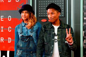 Model Helen Lasichanh (L) and recording artist Pharrell Williams attend the 2015 MTV Video Music Awards at Microsoft Theater on August 30, 2015 in Los Angeles, California.  (Photo by Frazer Harrison/Getty Images)