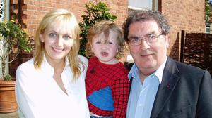 Treasured memory: A personal photograph from Miriam O'Callaghan taken in 2003 showing her with John Hume and her son Conor, who is now 18 years old
