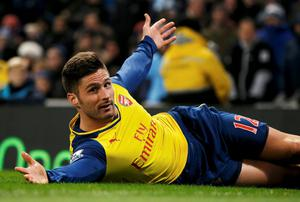 Arsenal's Olivier Giroud slides on the Etihad pitch to celebrate his goal against Manchester City. Photo: REUTERS/Phil Noble