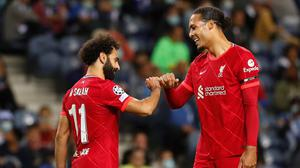 Liverpool's Mohamed Salah celebrates scoring their third goal with Virgil van Dijk in the Champions League Group B win over FC Porto at Estadio do Dragao, Porto, Portugal