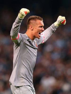 MANCHESTER, ENGLAND - SEPTEMBER 30:   Lukasz Skorupski of AS Roma celebrates his team's first goal during the UEFA Champions League Group E match between Manchester City FC and AS Roma  on September 30, 2014 in Manchester, United Kingdom.  (Photo by Alex Livesey/Getty Images)