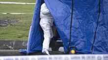 Gruesome: Forensic officers examine a holdall containing the severed limbs of  17-year-old Keane Mulready-Woods in Moatview in Coolock last week. Photo: Collins