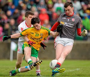 Donegal's Conor Doherty scores their goal despite the challenges of Tyrone's Conor Shields and Brendan Gallon OLIVER McVEIGH / SPORTSFILE