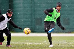 Daniel Sturridge trains amid the snow yesterday as he prepares to make his return to Brendan Rodgers' team