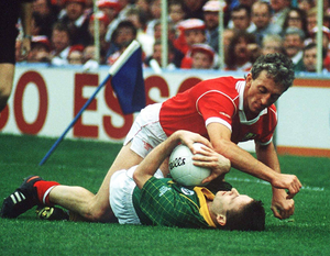 Take that: Conor Counihan of Cork and Meath's Bernard Flynn get up close and personal in the 1990 All-Ireland SFC finalr. Photo: Ray McManus/Sportsfile
