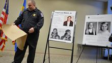 Police show photos of murder suspect Lloyd Welch and his alleged victims at a news conference in 2014 (The Washington Post /AP)