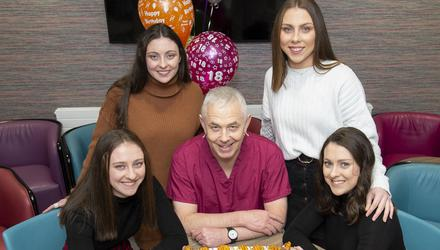 Cake for four: Consultant Professor John R Higgins with Katie, Kellie, Amy and Shauna Murphy