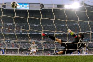 Juventus goalkeeper Gianluigi Buffon dives to the corner while Real Madrid's Cristiano Ronaldo scores 1-0 out of a penalty during the Champions League second leg semifinal soccer match between Real Madrid and Juventus, at the Santiago Bernabeu stadium in Madrid, Wednesday, May 13, 2015. (AP Photo/Daniel Ochoa de Olza)