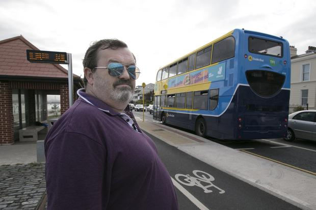 Vulnerable: Gary Kearney at the Clontarf bus stop where you have to cross a cycle lane. Photo: David Conachy
