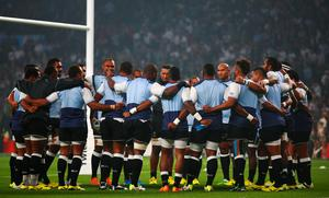 Fiji players huddle together prior to the 2015 Rugby World Cup Pool against England at Twickenham. Photo by Paul Gilham/Getty Images
