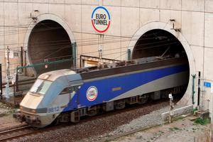 File photo dated 17/11/2009 of a train leaving the Euro Tunnel at Coquelles in France. Thousands of migrants stormed Eurotunnel's French terminal in Calais last night. PRESS ASSOCIATION Photo. Issue date: Tuesday July 28, 2015. Over the course of the night, some 2,000 attempted to breach the fences. The operator confirmed that the invasion was the cause of delays to this morning's service. See PA story POLICE Channel. Photo credit should read: Chris Ison/PA Wire