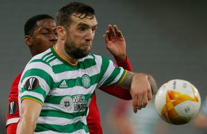 Celtic's Shane Duffy is first to the ball. Photo: AP