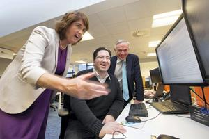 Tánaiste and Minister for Social Protection, Joan Burton, is pictured speaking with Paulo Mariano, Guidewire senior solutions consultant, and Minister for Jobs, Enterprise and Innovation, Richard Bruton  as they take a tour of Guidewire Software's Irish office in Blanchardstown, Dublin, where the company announced the creation of up to 80 new jobs. Picture Andres Poveda