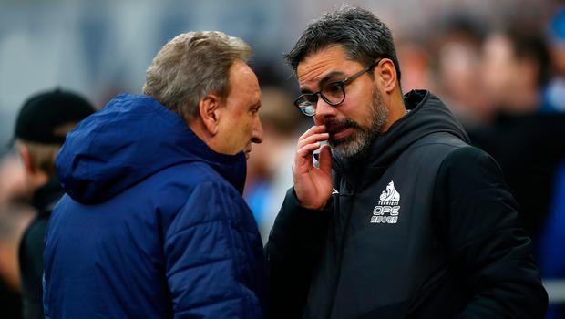 Huddersfield manager David Wagner (right) talks with Cardiff manager Neil Warnock. Photo: Getty Images