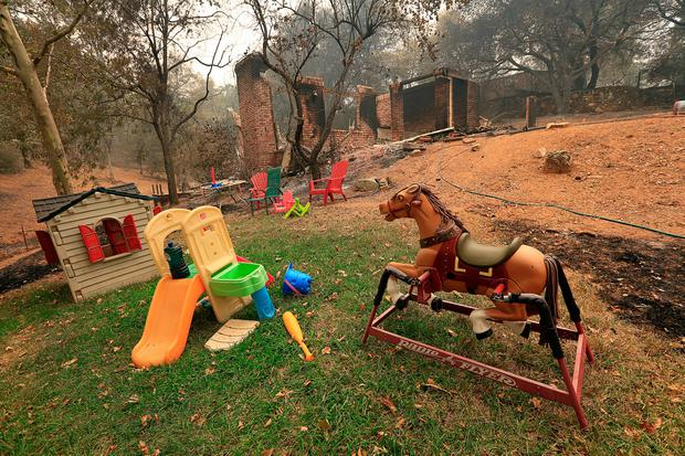 Toys stand untouched near a home destroyed by the Carr fire west of Redding, California. Photo: Bob Strong/REUTERS
