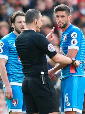 "AFC Bournemouth's Andrew Surman (right) is shown a red card by referee Kevin Friend during the Premier League match at Old Trafford, Manchester. PRESS ASSOCIATION Photo. Picture date: Saturday March 4, 2017. See PA story SOCCER Man Utd. Photo credit should read: Martin Rickett/PA Wire. RESTRICTIONS: EDITORIAL USE ONLY No use with unauthorised audio, video, data, fixture lists, club/league logos or ""live"" services. Online in-match use limited to 75 images, no video emulation. No use in betting, games or single club/league/player publications."
