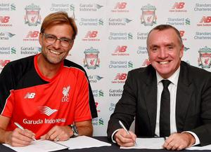 Juergen Klopp with Liverpool chairman Tom Werner after putting pen to paper on his contract