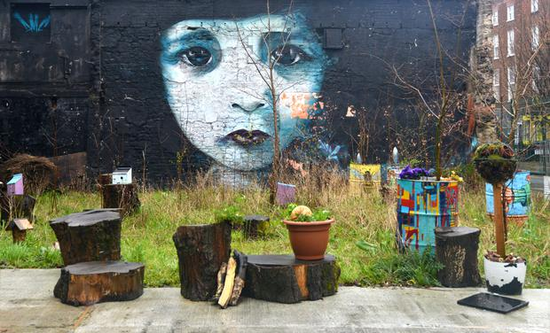 Street art in Limerick. The spectral child pictured is the work of Dermot McConaghy (DMC).
