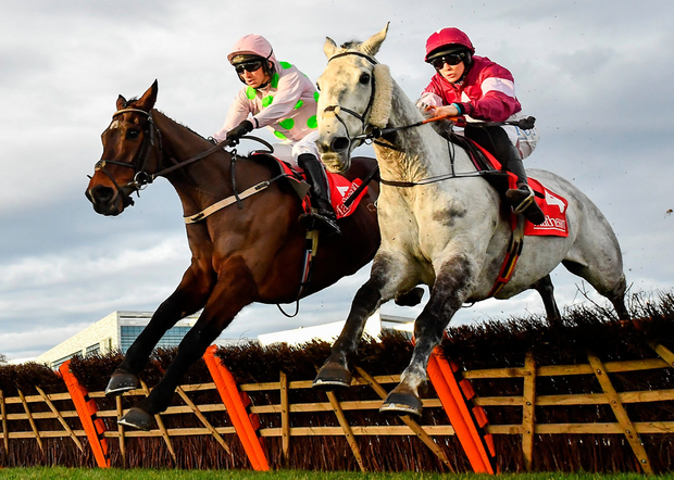 Sharjah (left) with Patrick Mullins on board jumps the last alongside Petit Mouchoir and Rachael Blackmore on their way to winning the Matheson Hurdle at Leopardstown. Photo: David Fitzgerald/Sportsfile