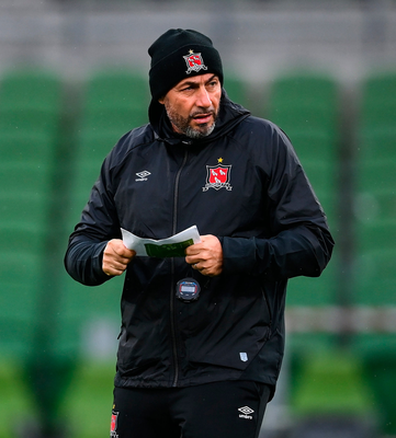 On the ball: Dundalk manager Filippo Giovagnoli checks his notes during a run-out for his team at the Aviva Stadium last night. Photo: Stephen McCarthy/Sportsfile