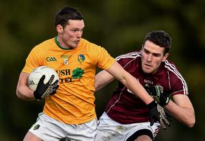 Paddy McGowan, Leitrim, in action against Fiontán O'Curraoin, Galway