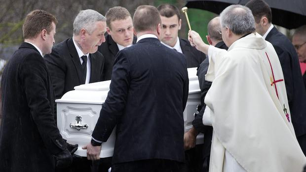 The coffin of Dale Creighton is carried from St Aidan's Church, Brookfield. Photo: Tony Gavin